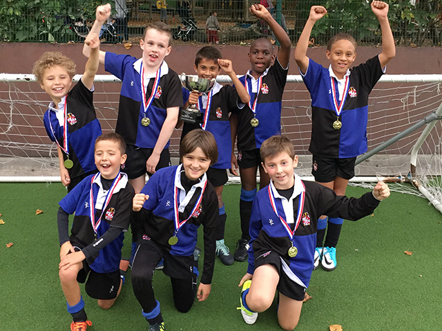 The U9s Lift the Cup: Eaton Square School 6-a-side Football Tournament